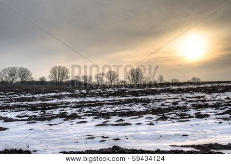 Sunrise Over Barren Field