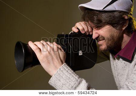 Man With Retro Camera Shoots The Film Stress
