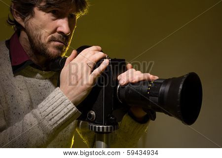 Man With Old Film Movie Camera.