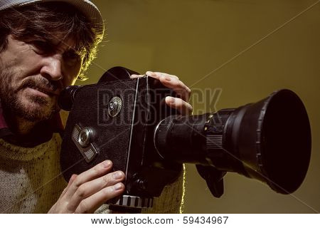 Man With Old Film Movie Camera. Shooting Of The Film