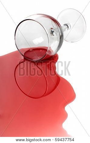 Broken glass and spilled red wine