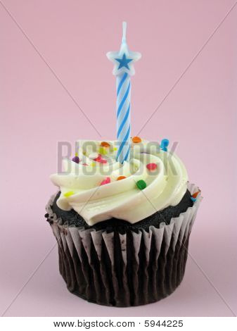 Chocolate cupcake with birthday candle