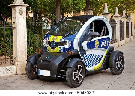VALENCIA, SPAIN - JANUARY 14, 2014: Renault Twizy police car on street of Valencia. This is ultra-compact, battery powered electric vehicle produced by Renault and manufactured in Valladolid, Spain.