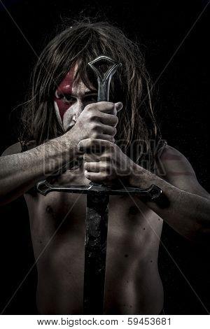 Battle.savage warrior with iron sword