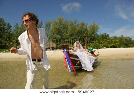 Newlyweds On The Beach