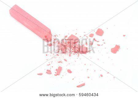 Crumbled pink chalk