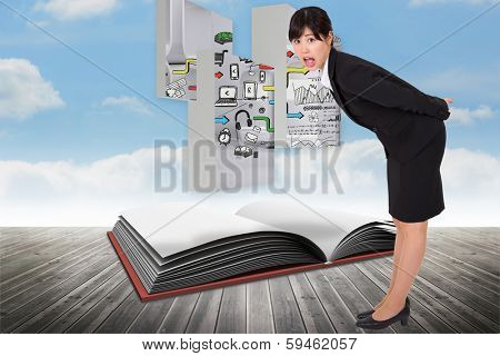 Surpised businesswoman bending against open book against sky