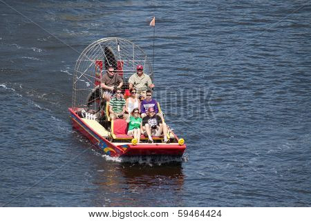 JACKSONVILLE, FL, USA - MARCH 17, 2013: A group of tourist starting an air boat ride in the St. Johns River in Jacksonville. Air boats are a very popular means of transportation in Florida waterways.