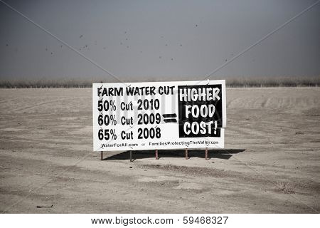 California's Drought causes farmers to post signs and fields to dry up and blow away in the wind. California experiences a drought about every 12 years or so.