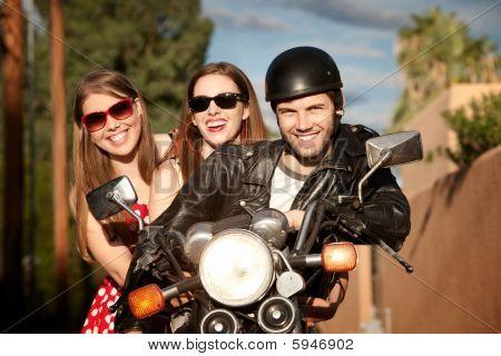 Trio Posing On Motorcycle