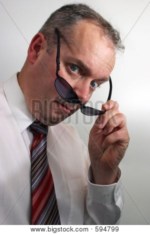 Businessman Takes Sunglasses Off