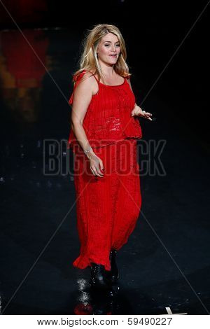 NEW YORK-FEB 6: Host Daphne Oz wears Sarah Liller on the runway at The Heart Truth Red Dress Collection show during Mercedes-Benz Fashion Week at Lincoln Center on February 6, 2014 in New York City.