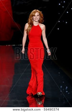 NEW YORK-FEB 6: Bella Thorne wears Badgley Mischka on the runway at The Heart Truth Red Dress Collection show during Mercedes-Benz Fashion Week at Lincoln Center on February 6, 2014 in New York City.