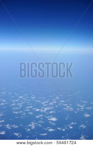 aerial view of blue sky with clouds from jet flight
