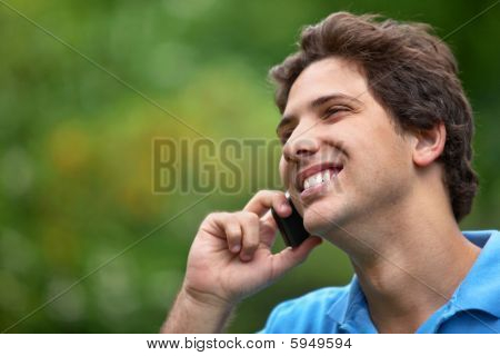 Man Outdoors On The Phone
