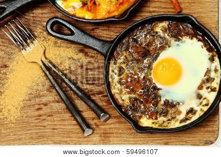 Spinach Dal and Egg Skillet Breakfast on table.