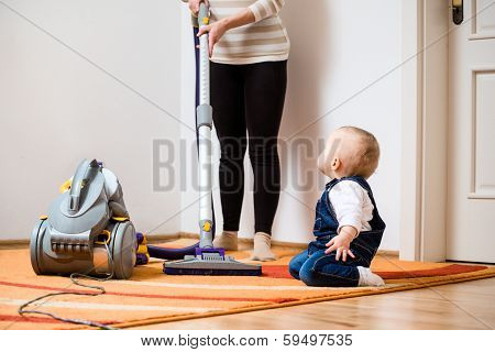 Cleaning home - mother with baby