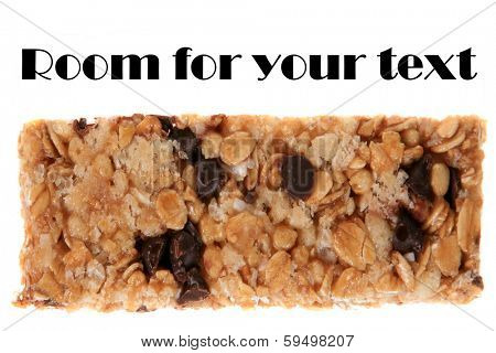 A very tasty and healthy Granola Bar chock full of Oats, Honey, Chocolate Chips, Peanuts, and other flavorful items to help make your day a bit better when your hungry for a snack. Isolated on white