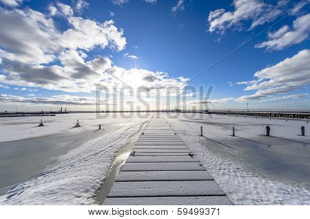 A Winter Seaview On The Pier, By Entrance To The Port, With Frozen Sea.