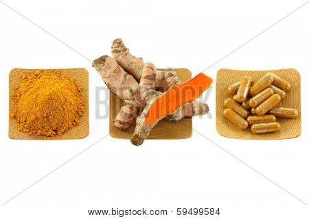 Turmeric rhizome, powder and capsules isolated on white