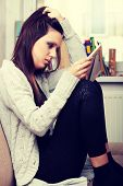 image of lost love  - Young sad woman sitting in children room  - JPG