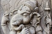 image of hindu-god  - Close up ganesh hindu god face made from stucco work - JPG