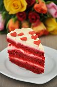 foto of red velvet cake  - Red Velvet Cake with Roses in the background - JPG
