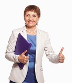 stock photo of 55-60 years old  - attractive woman 50 years old with a folder for documents on white background - JPG