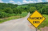 pic of maryland  - Motorists are warned of a change from asphalt to gravel on a country road in northern Maryland - JPG