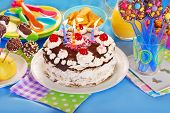 pic of torte  - chocolate torte with candles and homemade sweets for children birthday party - JPG