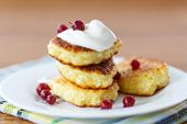 picture of curd  - curd cheese pancakes fried with powdered sugar and berries - JPG