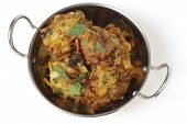 picture of kadai  - Homemade onion bhaji Indian appetisers in a kadai serving bowl - JPG