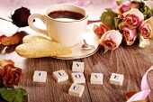 picture of scrabble  - I love you made of scrabble letters dried roses cup of coffee and heart shaped cookies with sugar for valentine on wooden table - JPG