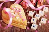 stock photo of scrabble  - I love you made of scrabble letters dried roses and heart shaped cookies with sprinkles for valentine on wooden table - JPG