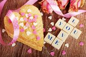 picture of scrabble  - I love you made of scrabble letters dried roses and heart shaped cookies with sprinkles for valentine on wooden table - JPG