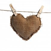 picture of grommets  - Valentine linen Sackcloth heart held by clothespins isolated on white - JPG