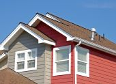 stock photo of gutter  - Isolated shot of roof top eaves on a newly built residential home - JPG