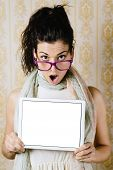stock photo of jaw drop  - Surprised woman showing digital tablet blank screen and jaw dropping - JPG