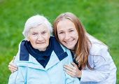 stock photo of hospice  - Portrait of elderly woman and her caregiver - JPG