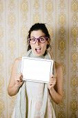 picture of jaw drop  - Surprised woman showing digital tablet blank screen and jaw dropping - JPG