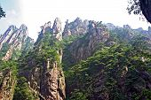 stock photo of shan  - Spectacular rocks and peaks of Huang Shan Mountains China fading in the morning sun  - JPG