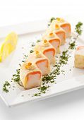 Maki Sushi - Roll made of Salmon and Rice inside. Pancake outside. Topped with Cream Cheese and Salm