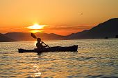 stock photo of raft  - Summer sunset kayaking in Montenegro - JPG