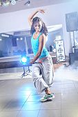picture of zumba  - young woman in sport dress at an aerobic and zumba exercise - JPG