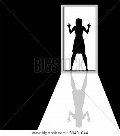 woman silhouette caught on the door