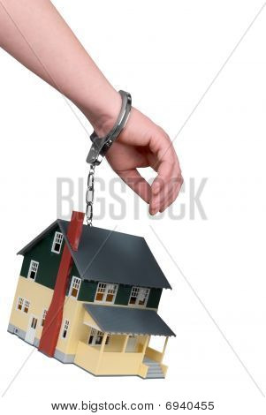One Hand Handcuffed To A House