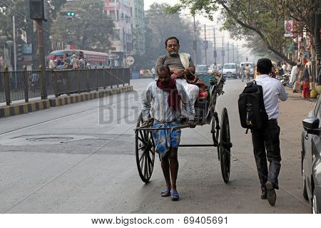 KOLKATA - FEB 15: rickshaw driver working on February 15, 2014 in Kolkata, India. Rickshaws have been around for more than a century, but they could soon be a thing of the past.