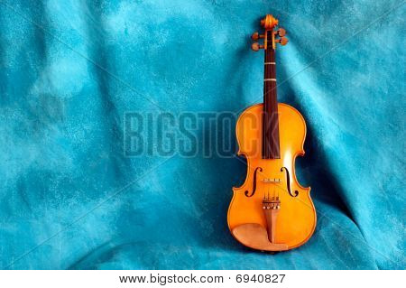Full Violin Against Blue Backdrop