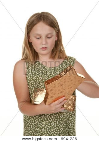 Girl Opening Present On White