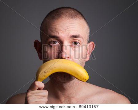 Man Holding A Banana With Sad Expression